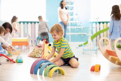 children playing colorful blocks