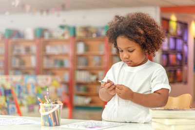 little toddler girl concentrate on drawing