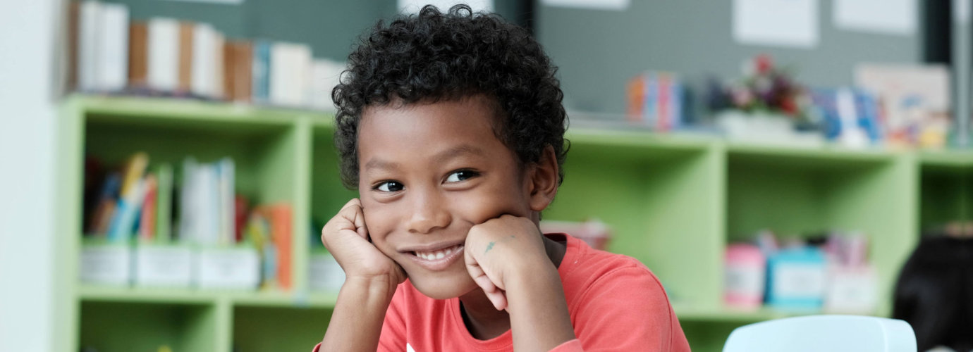 young boy smiling indoor